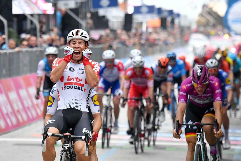 Australian cyclist Caleb Ewan celebrates while crossing the finish line to win the eighth stage of the Giro d'Italia cycling race, from Tortoreto Lido to Pesaro, Italy, Saturday, May 18, 2019. (Alessandro Di Meo/ANSA via AP)