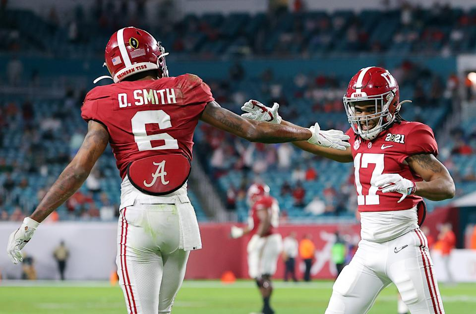 DeVonta Smith, left, and Jaylen Waddle, right, are expected to be first-round picks in the 2021 NFL draft. (Photo by Kevin C. Cox/Getty Images)