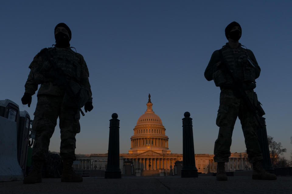 FILE - In this March 8, 2021, file photo National Guard stand their posts around the Capitol at sunrise in Washington. Authorities suggested for weeks in court hearings and papers that members of the Oath Keepers militia group planned their attack on the Capitol in advance in an effort to block the peaceful transition of power. But prosecutors have since said it's not clear whether the group was targeting the Capitol before Jan. 6, giving defense attorneys an opening to try to sow doubt in the government's case. (AP Photo/Carolyn Kaster, File)
