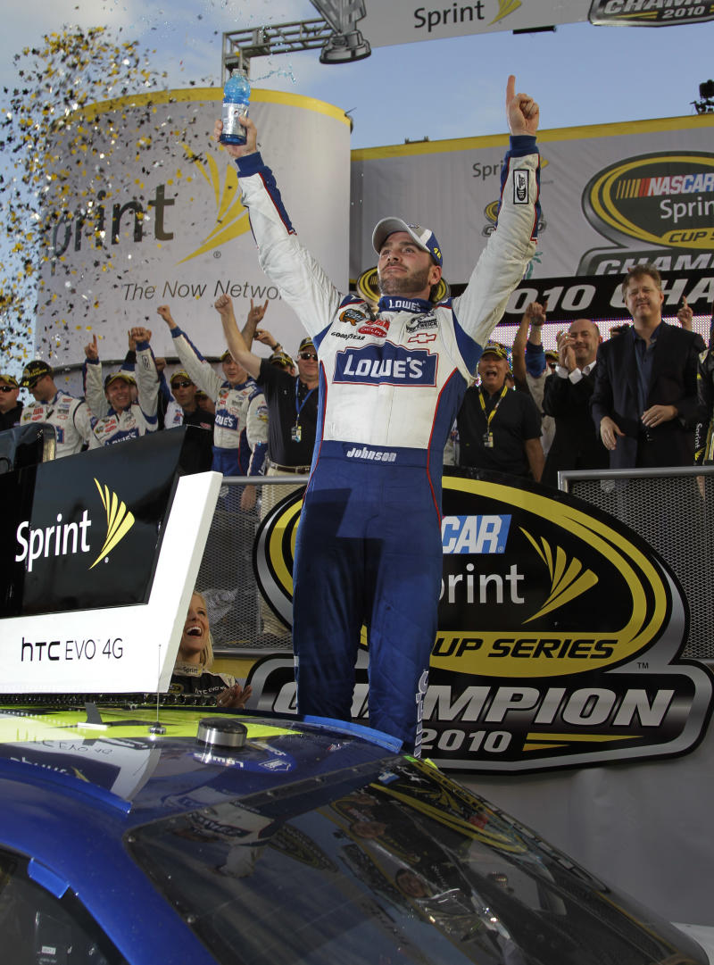 NASCAR driver JImmie Johnson celebrates after winning his fifth Sprint Cup Series Championship Sunday, Nov. 21, 2010 in Homestead, Fla.(AP Photo/Terry Renna)