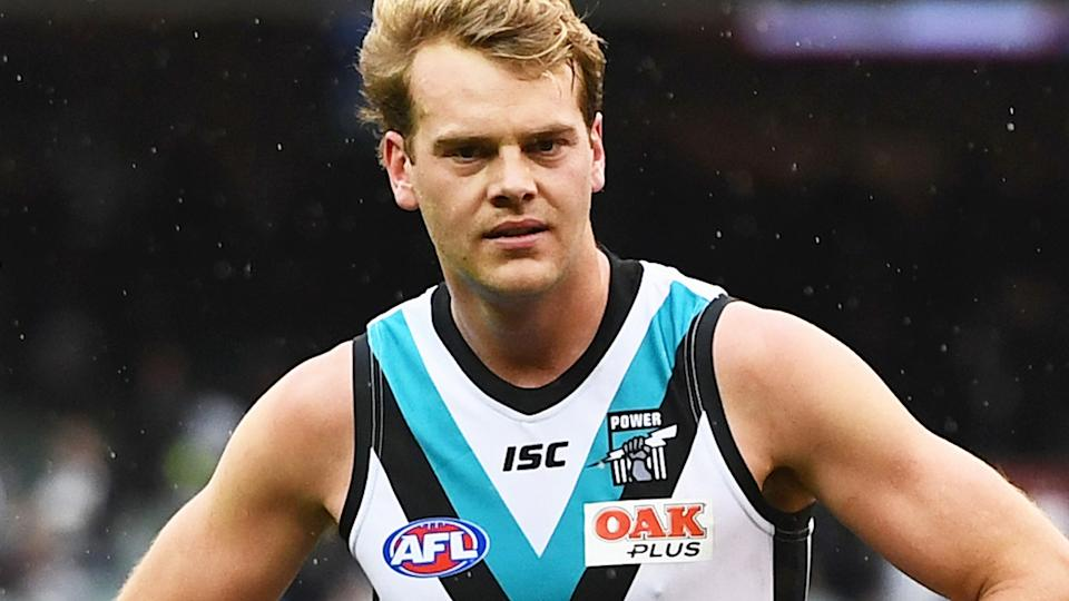 Jack Watts is pictured playing for Port Adelaide in the AFL.