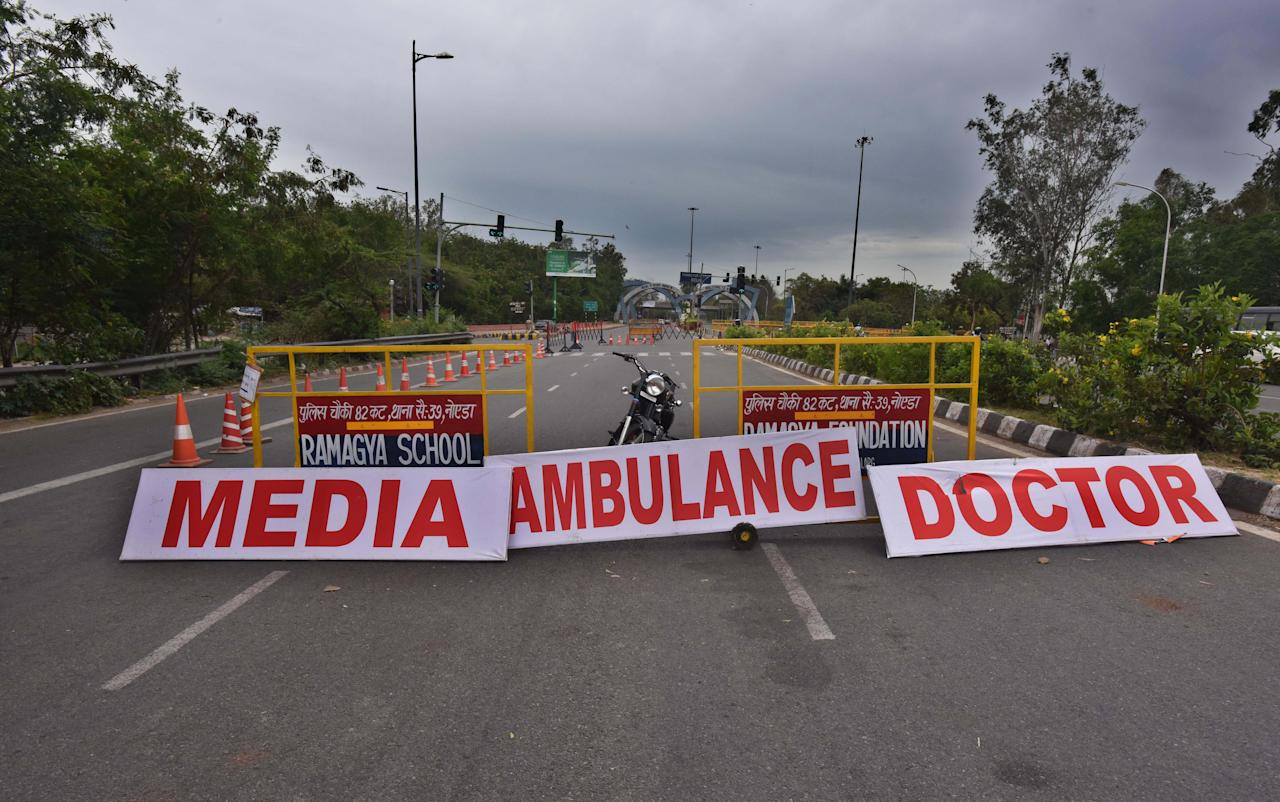 <strong>~ </strong>Supreme Court issues directions to media, including print, electronic and social media, to curb unverified and fake news related to COVID-19. (Police barricade and signs advertising passage for media and medical services. Photo by Raj K Raj/Hindustan Times via Getty Images)