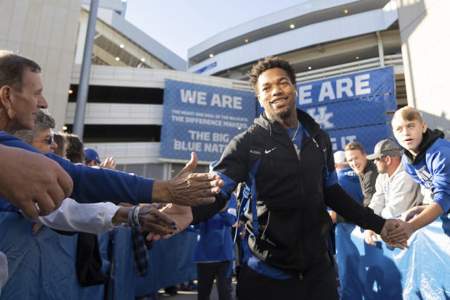 Kentucky wide receiver Lynn Bowden Jr. (1) greets fans during a pep rally before the team's NCAA college football game against Arkansas, Saturday, Oct. 12, 2019, in Lexington, Ky. (AP Photo/Bryan Woolston)