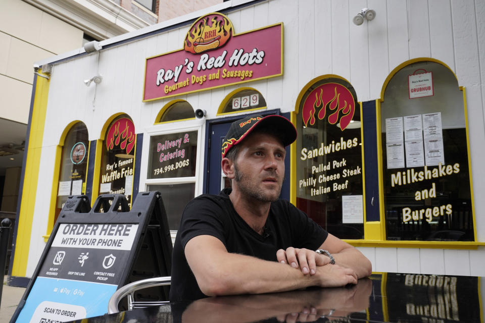 """Phil Clark, general manager at Ray's Red Hots, talks in Ann Arbor, Mich., July 7, 2021. Clark is exploring his options when it comes to striking endorsement deals with college athletes, calling the current situation """"sort of the wild West."""" (AP Photo/Paul Sancya)"""