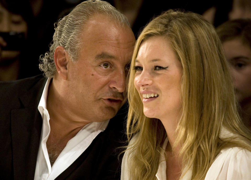 Super model Kate Moss and Top Shop owner Philip Green watch the Fashion for Relief charity fashion show in London September 20, 2007.      REUTERS/Kevin Coombs    (BRITAIN)