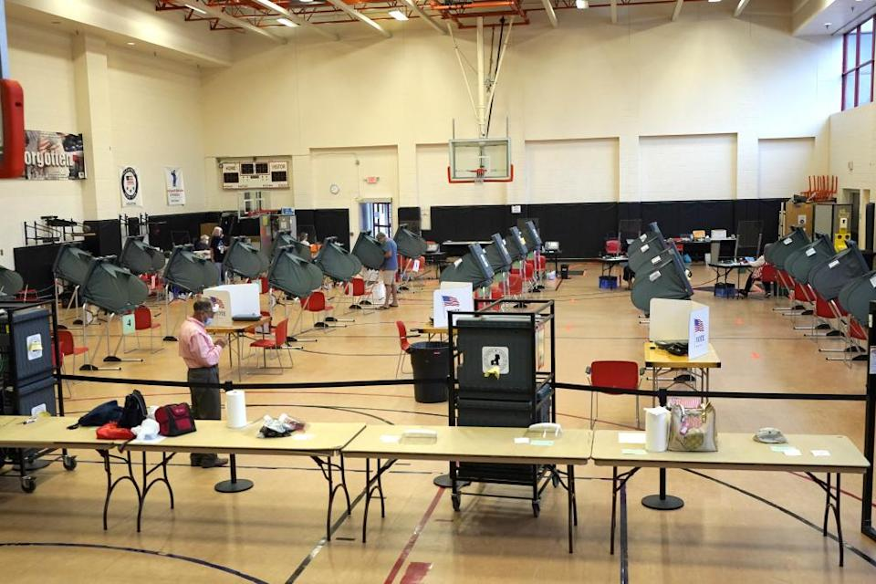 Voting booths are spaced out for social distancing at a polling site in Houston on June 29, 2020.