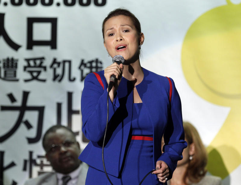 "FILE - This Oct. 15, 2010 file photo shows Filipino singer Lea Salonga performing on World Food Day, at the FAO (United Nations Food and Agriculture Organization) headquarters in Rome. Salonga, the original ""Miss Saigon"" who also starred in a Broadway revival of ""Flower Drum Song"" in 2002, will join the upcoming tour ""Il Divo _ A Musical Affair: The Greatest Songs of Broadway Live."" The tour kicks off on March 28 in Phoenix. (AP Photo/Alessandra Tarantino, File)"