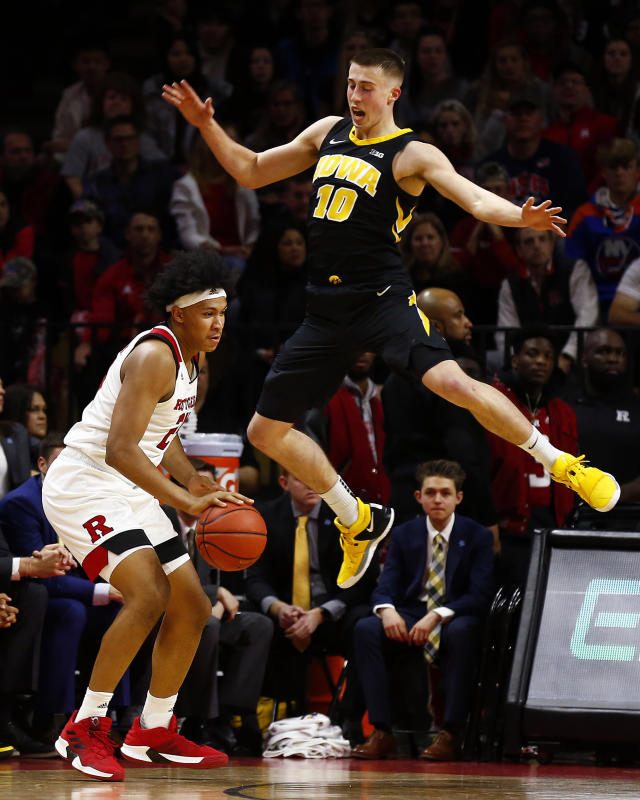 Iowa guard Joe Wieskamp (10) defends against Rutgers forward Ron Harper Jr. (24) during the first half of an NCAA college basketball game Saturday, Feb. 16, 2019, in Piscataway, N.J. (AP Photo/Adam Hunger)