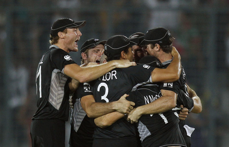 New Zealand cricketers react after winning against South Africa during the Cricket World Cup quarterfinal match between South Africa and New Zealand in Dhaka, Bangladesh, Friday, March 25, 2011. (AP Photo/Saurabh Das)