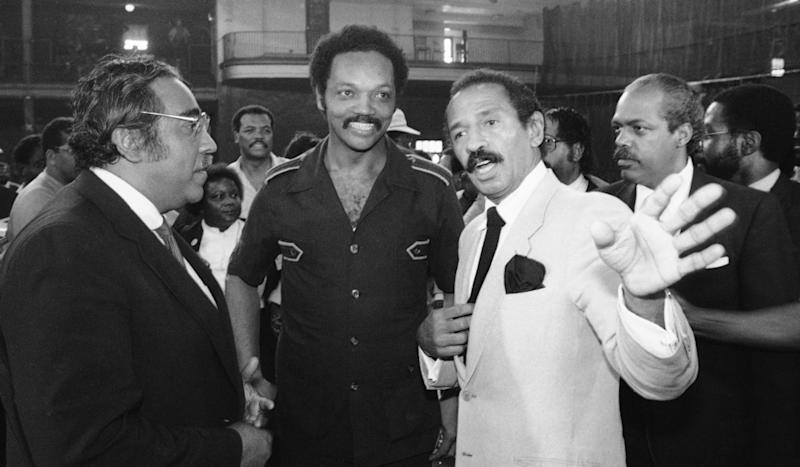 From right, Rep. John Conyers, the Rev Jesse Jackson and Rep. Charlie Rangel (D-N.Y.) confer at a congressional hearing on police brutality in September 1983.