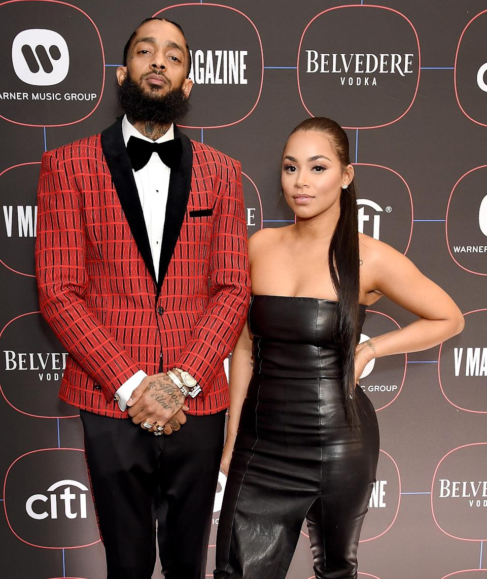 Nipsey Hussle and Lauren London arrive at the Warner Music Group Pre-Grammy Celebration at Nomad Hotel Los Angeles on Feb. 7, 2019, in Los Angeles.