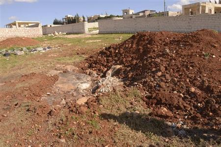 A general view shows what forces loyal to Syria's President Bashar al-Assad say is the site where Tuesday's chemical weapon attack occurred