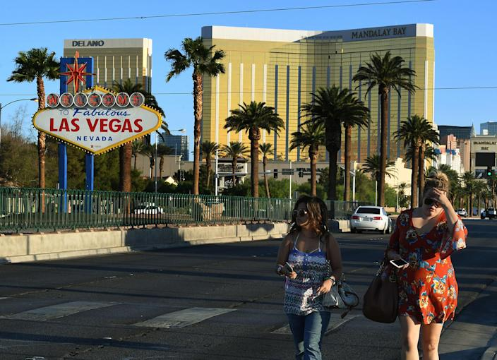Two festivalgoers leave the area around the Mandalay Bay Hotel in Las Vegas on Oct. 2, 2017. (Photo: Mark Ralston/AFP/Getty Images)