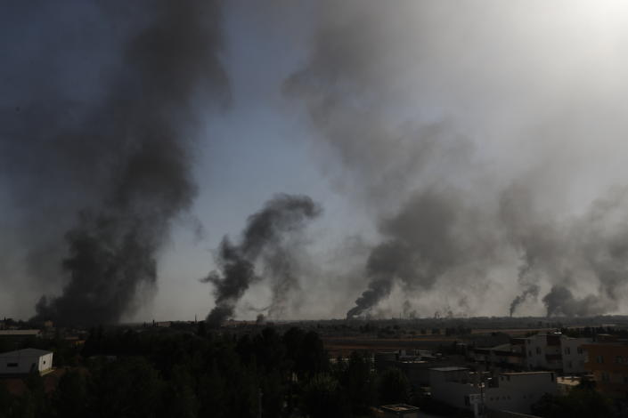In this photo taken from the Turkish side of the border between Turkey and Syria, in Akcakale, Sanliurfa province, southeastern Turkey, smoke billows from targets inside Syria during bombardment by Turkish forces, Oct. 10, 2019. (AP Photo/Lefteris Pitarakis)