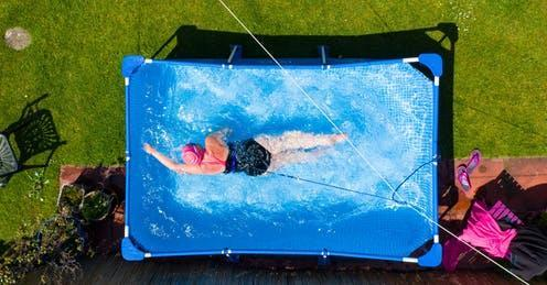"""<span class=""""caption"""">Wild swimmer Fiona Philp from Limekilns, Scotland took a daily dip in her garden pool during lockdown.</span> <span class=""""attribution""""><a class=""""link rapid-noclick-resp"""" href=""""https://www.alamy.com/limekilns-scotland-uk-20-may-2020-fiona-philp-59-from-limekilns-fife-a-wild-open-water-swimmer-with-the-fife-wild-swimmers-group-during-a-daily-dip-in-her-garden-pool-many-wild-swimmers-have-been-denied-the-opportunity-to-pursue-their-sport-during-covid-19-lockdown-and-have-purchased-pools-for-their-gardens-to-maintain-their-wellbeing-iain-mastertonalamy-live-news-image358369229.html?pv=1&stamp=2&imageid=9844EE35-18BD-4E8C-9E5D-30D2F955584B&p=5379&n=0&orientation=0&pn=1&searchtype=0&IsFromSearch=1&srch=foo%3dbar%26st%3d0%26pn%3d1%26ps%3d100%26sortby%3d2%26resultview%3dsortbyPopular%26npgs%3d0%26qt%3duk%2520home%2520lockdown%2520pool%26qt_raw%3duk%2520home%2520lockdown%2520pool%26lic%3d3%26mr%3d0%26pr%3d0%26ot%3d0%26creative%3d%26ag%3d0%26hc%3d0%26pc%3d%26blackwhite%3d%26cutout%3d%26tbar%3d1%26et%3d0x000000000000000000000%26vp%3d0%26loc%3d0%26imgt%3d0%26dtfr%3d%26dtto%3d%26size%3d0xFF%26archive%3d1%26groupid%3d%26pseudoid%3d%26a%3d%26cdid%3d%26cdsrt%3d%26name%3d%26qn%3d%26apalib%3d%26apalic%3d%26lightbox%3d%26gname%3d%26gtype%3d%26xstx%3d0%26simid%3d%26saveQry%3d%26editorial%3d%26nu%3d%26t%3d%26edoptin%3d%26customgeoip%3dGB%26cap%3d1%26cbstore%3d1%26vd%3d0%26lb%3d%26fi%3d2%26edrf%3d0%26ispremium%3d1%26flip%3d0%26pl%3d"""" rel=""""nofollow noopener"""" target=""""_blank"""" data-ylk=""""slk:Iain Masterton/Alamy Stock Photo"""">Iain Masterton/Alamy Stock Photo</a></span>"""