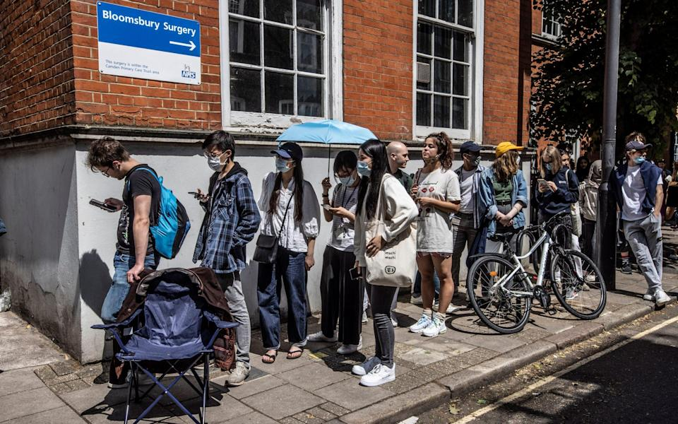 Students queue for coronavirus vaccinations at Bloomsbury Surgery in London - Jeff Gilbert