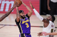 Los Angeles Lakers' Anthony Davis (3) moves the ball against Denver Nuggets' Paul Millsap (4) during the second half of an NBA conference final playoff basketball game Saturday, Sept. 26, 2020, in Lake Buena Vista, Fla. (AP Photo/Mark J. Terrill)