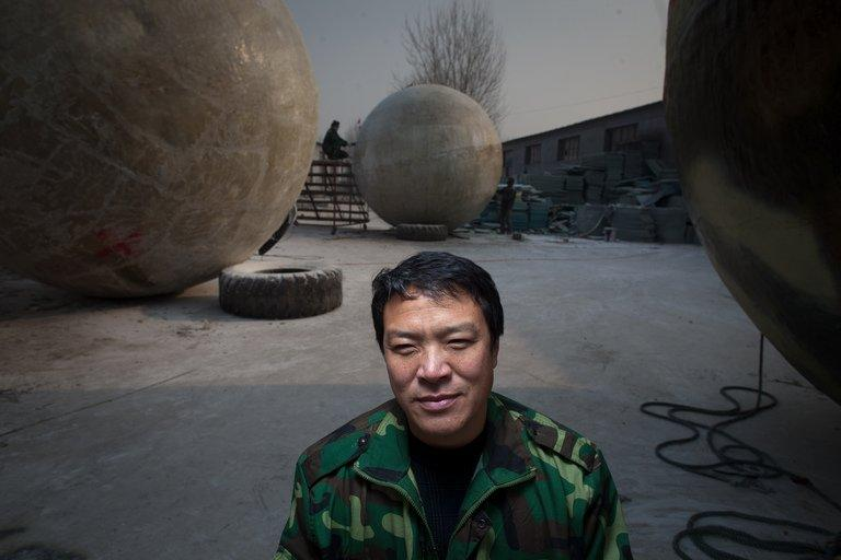 This photo taken on December 11, 2012 shows Chinese farmer Liu Qiyuan with the survival pods that he created