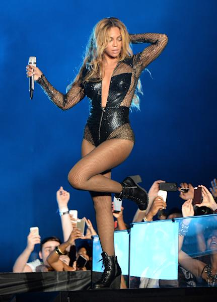 Beyoncé has made her entrance wearing a sequined long-sleeved black Versace leotard with a plunging neckline.