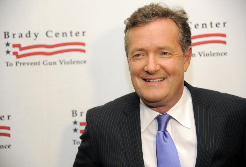 """FILE - In this May 7, 2013, file photo, honoree Piers Morgan poses at the Brady Campaign to Prevent Gun Violence Los Angeles Gala at The Beverly Hills Hotel in Beverly Hills, Calif. CNN said Sunday, Feb. 23, 2014, that the prime-time talk show """"Piers Morgan Live"""" is coming to an end and that the show's final airdate has yet to be determined. (Photo by Chris Pizzello/Invision/AP, File)"""