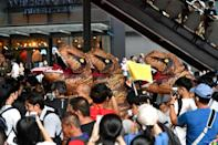 The dinosaurs represented the older generation of Thai politicians, activists said
