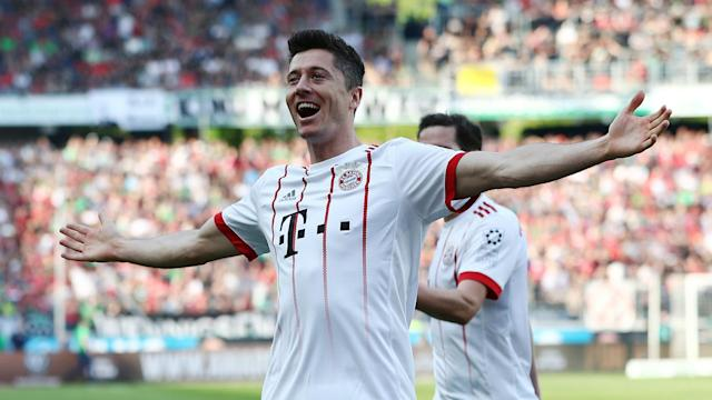 Bundesliga champions Bayern Munich marched on with a comfortable win against Hannover, Robert Lewandowski scoring a landmark goal.