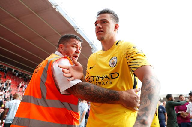 "Soccer Football - Premier League - Southampton vs Manchester City - St Mary's Stadium, Southampton, Britain - May 13, 2018 Manchester City's Ederson is restrained by stewards as he celebrates after the match Action Images via Reuters/John Sibley EDITORIAL USE ONLY. No use with unauthorized audio, video, data, fixture lists, club/league logos or ""live"" services. Online in-match use limited to 75 images, no video emulation. No use in betting, games or single club/league/player publications. Please contact your account representative for further details."
