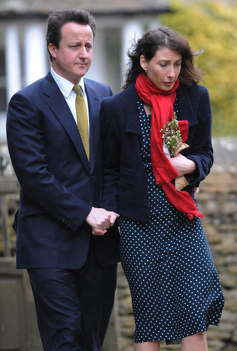 Conservative Party leader David Cameron and his wife Samantha arrive at St Nicholas Church in Chadlington, Oxfordshire for the funeral of their son Ivan who died last week.