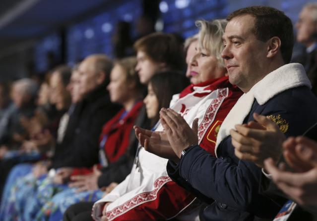 Russia's Prime Minister Dmitry Medvedev (R) attends the opening ceremony of the 2014 Sochi Winter Olympics, February 7, 2014. REUTERS/Dmitry Astakhov/RIA Novosti/Pool (RUSSIA - Tags: POLITICS OLYMPICS SPORT) ATTENTION EDITORS - THIS IMAGE HAS BEEN SUPPLIED BY A THIRD PARTY. IT IS DISTRIBUTED, EXACTLY AS RECEIVED BY REUTERS, AS A SERVICE TO CLIENTS