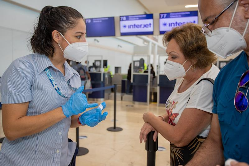 CANCUN, MEXICO - OCTOBER 2,2020: A health worker take a blood sample from a passenger to perform a rapid test to detect the SARS-COV2 that causes the Coronavirus disease (Covid-19). New safety measures are being taken at airports to prevent the spread of the virus on October 2, 2020 in Cancun, Mexico- PHOTOGRAPH BY Rodolfo Flores / Eyepix Group/ Barcroft Studios / Future Publishing (Photo credit should read Rodolfo Flores / Eyepix Group/Barcroft Media via Getty Images)