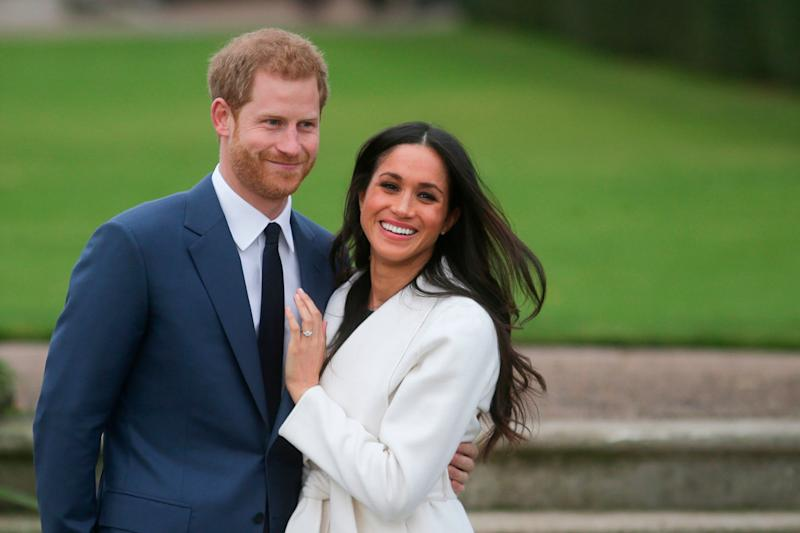 Prince Harry and Meghan Markle pose for a photo after announcing their engagement on Nov. 27, 2017.