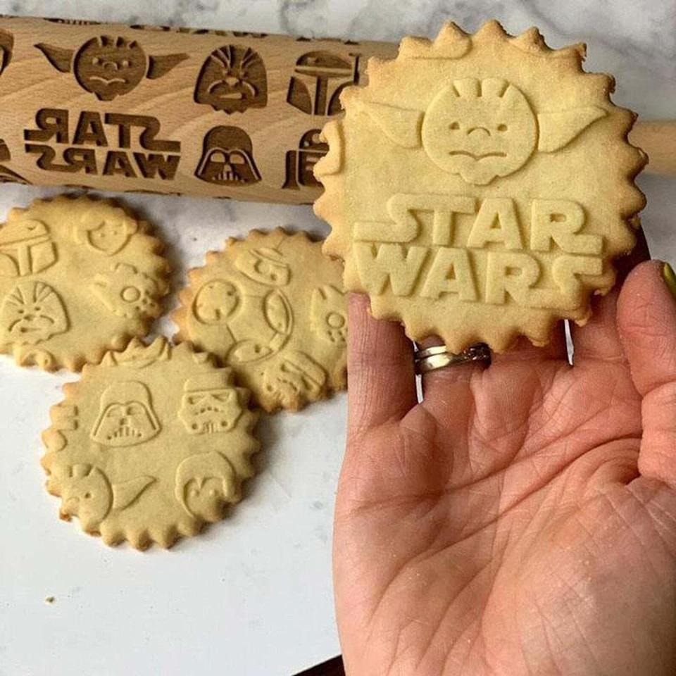 """It'll imprint fun Star Wars designs on your dough. Ready to chow down on the coolest-looking batch of cookies you've ever made? Pastrymadeis a woman-owned small business based in Warsaw, Poland, that offers a unique and beautiful array of embossed rolling pins to raise your baked treats to the next level. Your kitchen? It's about to become a five-star bakery.<br /><br /><strong>Promising review:</strong>""""My mom makes cookies with my nieces every Christmas. They are all big<i>Star Wars</i>fans and had a ball making cookies with this rolling pin. I would buy this again."""" — <a href=""""https://go.skimresources.com?id=38395X987171&xs=1&xcust=HPKitchenProductsDidntKnowExisted-60a3fc0fe4b063dcceaf8560-&url=https%3A%2F%2Fwww.etsy.com%2Flisting%2F821861828%2Fstar-wars-rolling-pin-embossing-rolling"""" target=""""_blank"""" rel=""""noopener noreferrer"""">Alina C. Perez</a><br /><br /><strong><a href=""""https://go.skimresources.com?id=38395X987171&xs=1&xcust=HPKitchenProductsDidntKnowExisted-60a3fc0fe4b063dcceaf8560-&url=https%3A%2F%2Fwww.etsy.com%2Flisting%2F821861828%2Fstar-wars-rolling-pin-embossing-rolling"""" target=""""_blank"""" rel=""""noopener noreferrer"""">Get it from Pastrymade on Etsy for $24.95+ (available in two sizes).</a></strong>"""