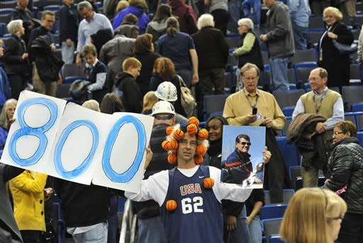 Connecticut fan Danny Karkowski holds up an 800-win sign and a photo of coach Geno Auriemma at the end of Connecticut's NCAA college basketball game against Notre Dame in the finalsof the Big East women's tournament in Hartford, Conn., Tuesday, March 6, 2012. Connecticut won 63-54, and Auriemma earned his 800th career win. (AP Photo/Jessica Hill)