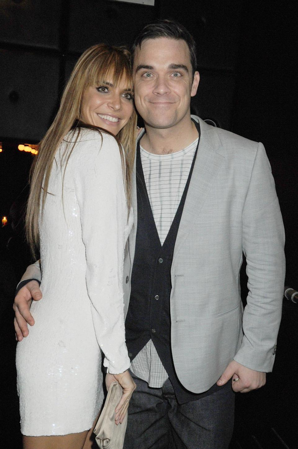 Ayda Field and Robbie Williams attend the Brit Awards after party held by EMI at the Supper Club on February 16, 2010 in London, England. (Photo by Dave M. Benett/Getty Images)