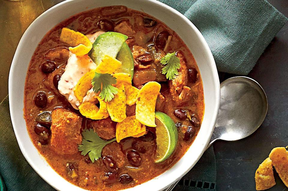 """<p><strong>Recipe: <a href=""""https://www.southernliving.com/recipes/chili-verde-pork"""" rel=""""nofollow noopener"""" target=""""_blank"""" data-ylk=""""slk:Pork Chili Verde"""" class=""""link rapid-noclick-resp"""">Pork Chili Verde</a></strong></p> <p>Fresh tomatillos look like small green tomatoes wrapped in thin papery skin. Remove skin, and rinse before chopping. If you can't find fresh, look for canned on the Latin aisle at the grocery.</p>"""
