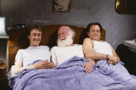 Actors (L-R) Nicholas Lyndhurst, Buster Merryfield and David Jason pictured in bed together during the filming of episode 'The Class of '62' of the BBC Television sitcom 'Only Fools and Horses', December 20th 1990. (Photo by Don Smith/Radio Times/Getty Images)