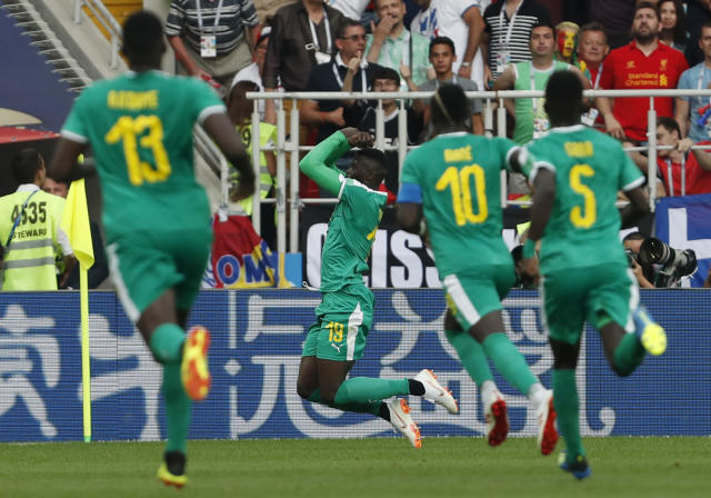Senegal's Mbaye Niang, 2nd left, celebrates with teammates after scoring his side's 2nd goal during the group H match between Poland and Senegal at the 2018 soccer World Cup in the Spartak Stadium in Moscow, Russia, Tuesday, June 19, 2018. (AP Photo/Darko Vojinovic)