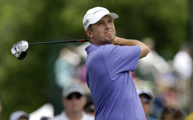 David Toms watches his tee shot on the third hole during the final round of the PGA Colonial golf tournament in Fort Worth, Texas, Sunday, May 25, 2014. (AP Photo/LM Otero)