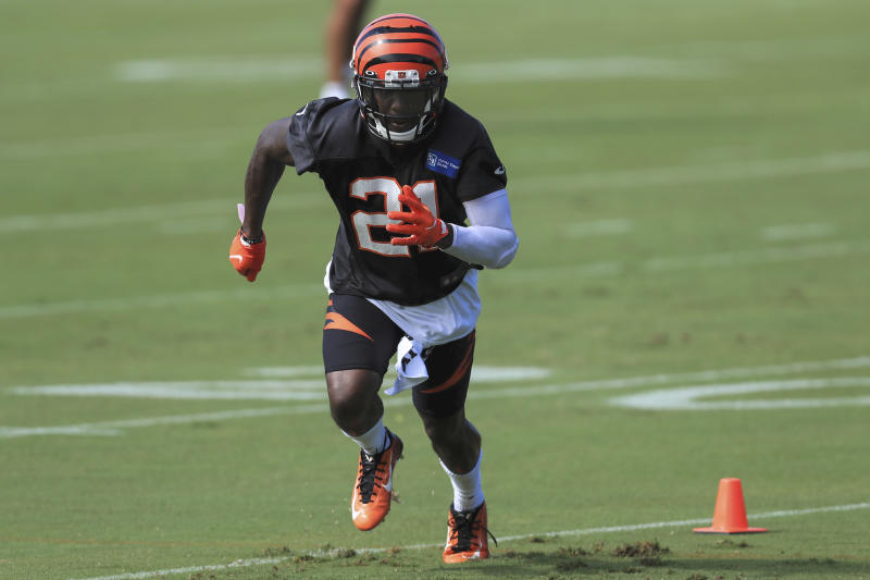 FILE - In this Monday, Aug. 17, 2020, file photo, Cincinnati Bengals' Mackensie Alexander (21) runs a drill during an NFL football camp practice in Cincinnati. Mackensie Alexander was jailed Wednesday, Aug. 26, 2020, charged with misdemeanor battery, after deputies say he beat up a man shortly after Alexander returned to Florida to help search for his missing father. Alexander, 26, and another man, 28-year-old Evins Clement, were arrested by Collier County sheriff's deputies Tuesday nightn (AP Photo/Aaron Doster, File)