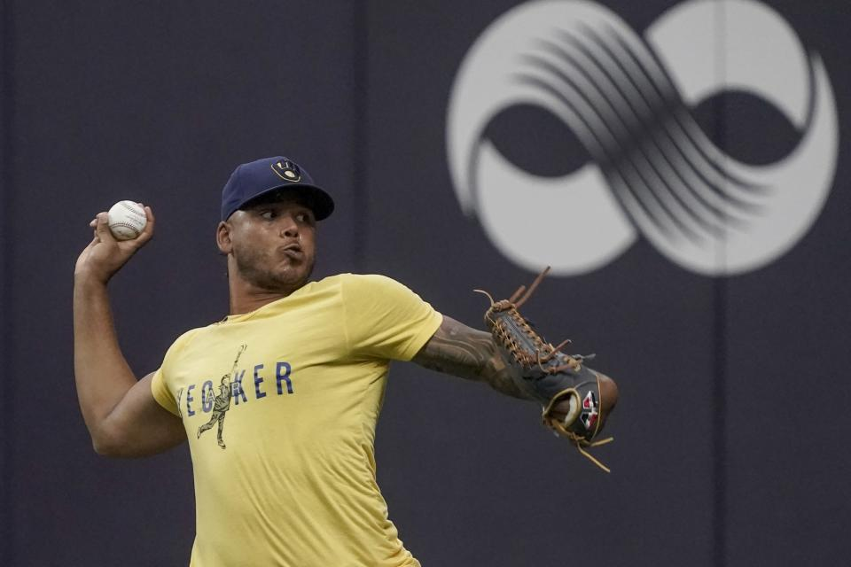 Milwaukee Brewers' Freddy Peralta throws at a practice for the Game 1 of the NLDS baseball game Thursday, Oct. 7, 2021, in Milwaukee. The Brewers plays the Atlanta Braves in Game 1 on Friday, Oct. 8, 2021. (AP Photo/Morry Gash)
