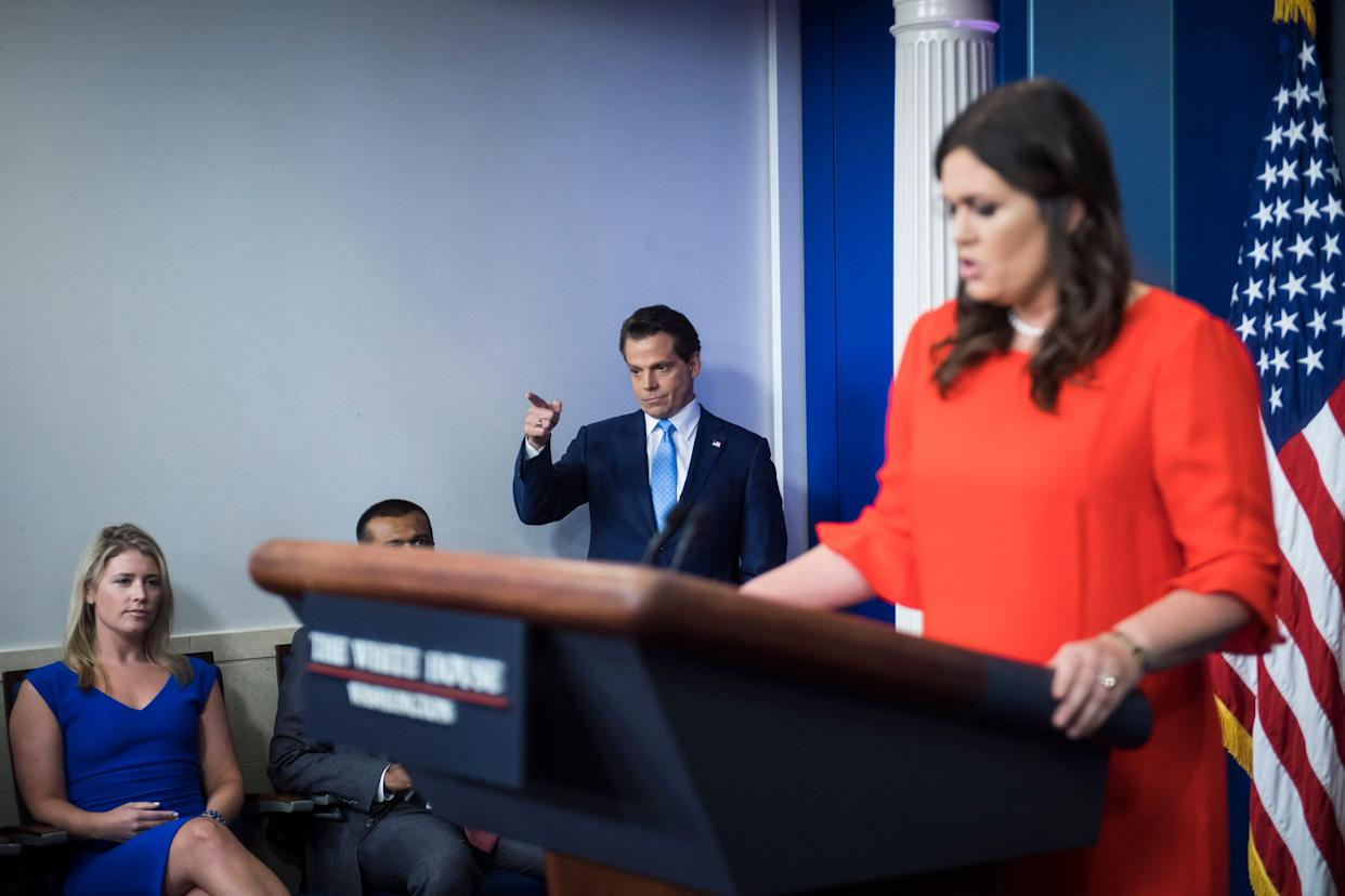 Scaramucci points as he follows new White House press secretary Sarah Huckabee Sanders into the briefing room at the White House on July 21, 2017.