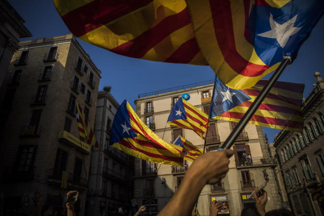 "<p>People wave independence flags just after the speech of Catalan regional president Carles Puigdemont in Barcelona, Spain, Thursday, Oct. 26, 2017. Puigdemont said Thursday he considered calling a snap election, but was choosing not to because he didn't receive enough guarantees that the government's ""abusive"" moves to take control of Catalonia would be suspended. (AP Photo/Santi Palacios) </p>"