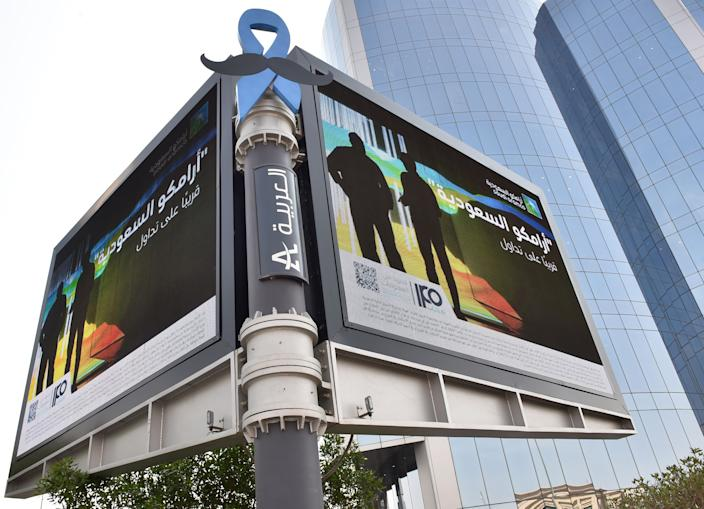 A billboard displaying an advert for Aramco is pictured in the Saudi capital Riyadh on November 10, 2019. - From robots to sniffer drones, Saudi Aramco has ramped up spending on technological innovation while its rivals cut back amid soft oil prices, but the energy giant risks losing its edge after its much-anticipated IPO. Saudi Arabia is offering a sliver of the company, touted as the kingdom's crown jewel, in its upcoming initial public offering that is the bedrock of Crown Prince Mohammed bin Salman's ambitious strategy to overhaul the oil-reliant economy. (Photo by FAYEZ NURELDINE / AFP) / The erroneous mention[s] appearing in the metadata of this photo by FAYEZ NURELDINE has been modified in AFP systems in the following manner: [november] instead of [october]. Please immediately remove the erroneous mention[s] from all your online services and delete it (them) from your servers. If you have been authorized by AFP to distribute it (them) to third parties, please ensure that the same actions are carried out by them. Failure to promptly comply with these instructions will entail liability on your part for any continued or post notification usage. Therefore we thank you very much for all your attention and prompt action. We are sorry for the inconvenience this notification may cause and remain at your disposal for any further information you may require. (Photo by FAYEZ NURELDINE/AFP via Getty Images)