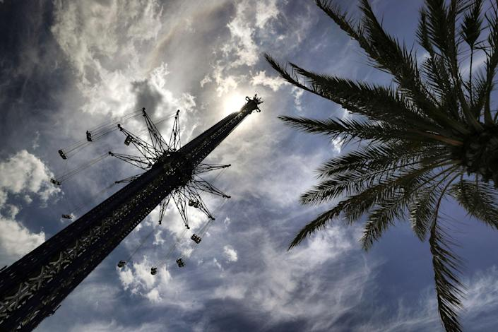 The StarFlyer attraction at Orlando's ICON Park, where an employee fell to their death on Monday (AP)