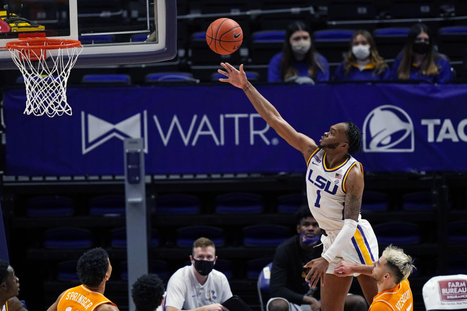 LSU guard Ja'Vonte Smart (1) goes to the basket over Tennessee guard Santiago Vescovi in the second half of an NCAA college basketball game in Baton Rouge, La., Saturday, Feb. 13, 2021. (AP Photo/Gerald Herbert)