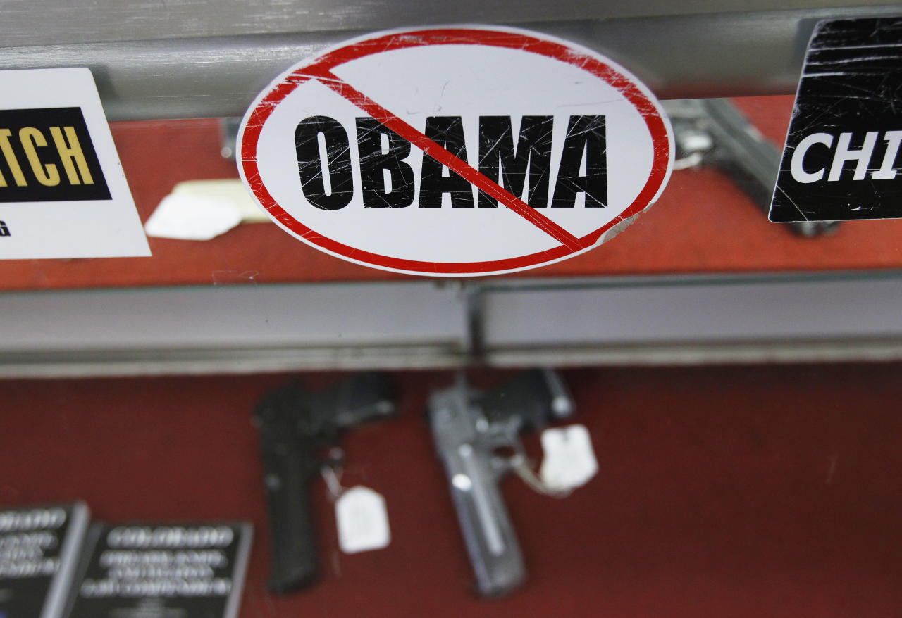 A sticker is seen at the Rocky Mountain Guns and Ammo store in Parker, Colorado July 24, 2012. The killing of 12 people at a midnight screening of the new Batman movie in the Denver suburb of Aurora may spark a fresh round of soul-searching on America's relationship with guns but few predict any real change in the law.  REUTERS/Shannon Stapleton (UNITED STATES - Tags: SOCIETY CRIME LAW)
