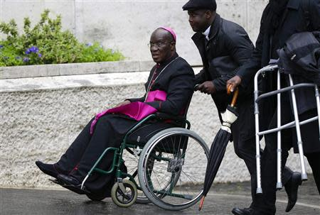 Bishop Jean-Pierre Kutwa of Ivory Coast arrives on a wheelchair to attend a special consistory for the family led by Pope Francis in the Paul VI's hall at the Vatican February 20, 2014. REUTERS/Max Rossi