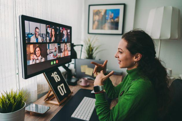 Businesspeople discussing business on virtual staff meeting during pandemic (Photo: martin-dm via Getty Images)