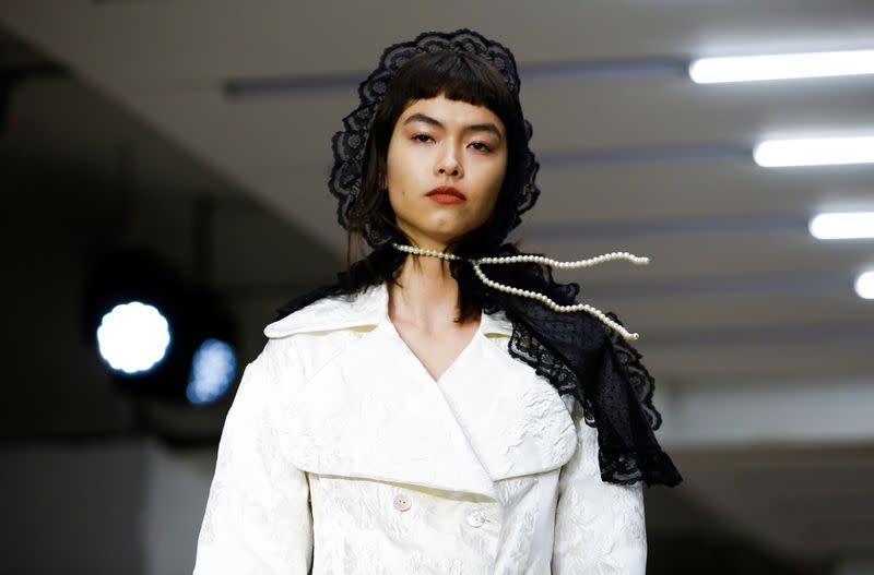 Models present creations during the Yuhan Wang catwalk show at London Fashion Week in London