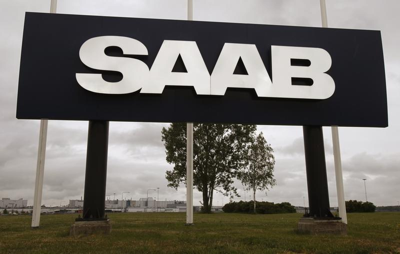 A large sign with the Saab logo stands outside the main Saab factory in Trollhattan